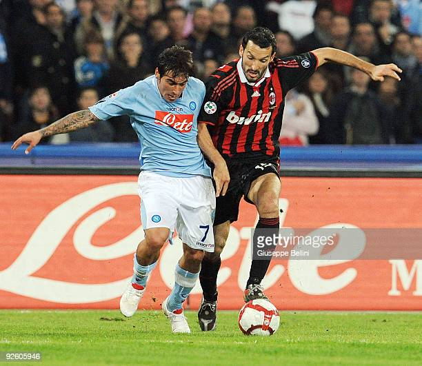 Ezequiel Lavezzi SSC Napoli and Gianluca Zambrotta AC Milan in action during the Serie A match between SSC Napoli and AC Milan at Stadio San Paolo on...