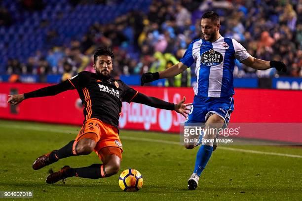 Ezequiel Marcelo Garay of Valencia CF competes for the ball with Florin Andone of Deportivo de La Coruna during the La Liga match between Deportivo...