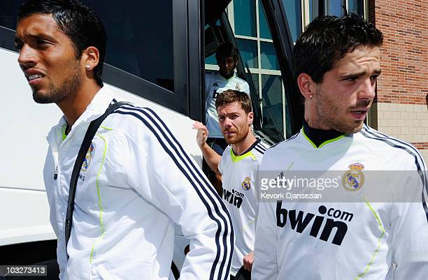 Ezequiel Marcelo Garay Xabi Alonso and Fernando Rubén Gago of Real Madrid arrive to participate in the Adidas training with local youth soccer...