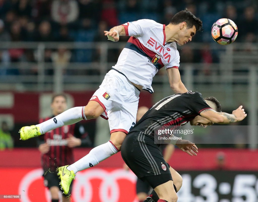 Ezequiel Munoz of Genoa CFC jumps for the ball with Lucas Ocampos of...  News Photo - Getty Images