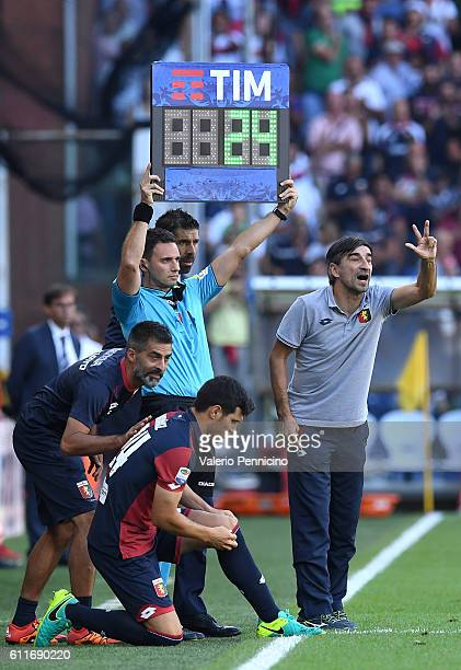 Ezequiel Munoz of Genoa CFC replaces a teammate during the Serie A match between Genoa CFC and Pescara Calcio at Stadio Luigi Ferraris on September...