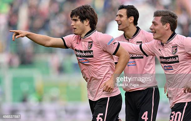 Ezequiel Munoz of Palermo celebrates with teammates after scoring the opening goal during the Serie B match between US Citta di Palermo and AS...