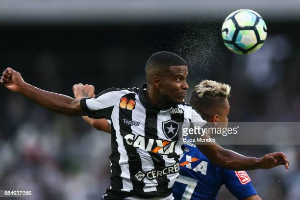 Ezequiel of Botafogo struggles for the ball with Bryan of Cruzeiro during a match between Botafogo and Cruzeiro as part of Brasileirao Series A 2017...