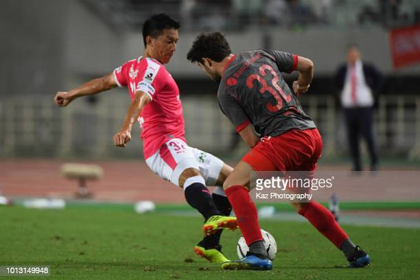 Ezequiel Osvaldo Cerutti of Independiente and Atomu Tanaka of Cerezo Osaka compete for the ball during the Suruga Bank Championship match between...