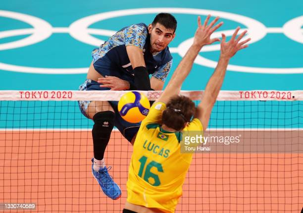 Ezequiel Palacios of Team Argentina competes against Lucas Saatkamp of Team Brazil during the Men's Preliminary Round - Pool B volleyball on day...