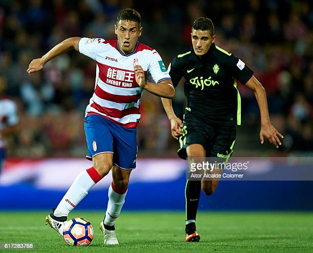 Ezequiel Ponce of Granada CF being followed by Rachid AitAtmane of Sporting Gijon during the match between Granada CF vs Sporting Gijon as part of La...