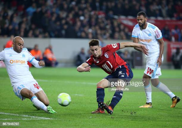 Ezequiel Ponce of Lille between Aymen Abdennour and Rolando of OM during the French Ligue 1 match between Lille OSC and Olympique de Marseille at...