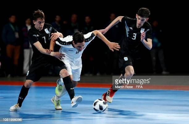 Ezequiel Ramirez and Alan de Candia of Argentina challenge Muntadher Qusay of Iraq in the Men's Futsal Group A match between Argentina and Iraq...