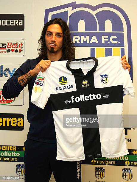 Ezequiel Schelotto new signing for Parma FC poses with the club shirt during a press conference at the club's training ground on January 22 2014 in...