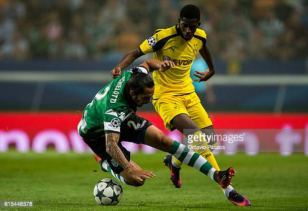 Ezequiel Schelotto of SC Sporting competes for the ball with Ousmane Dembélé of Borussia Dortmund during the UEFA Champions League match between SC...