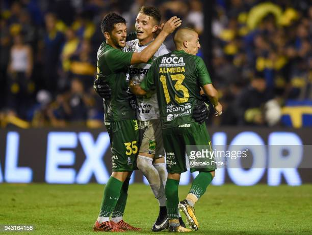 Ezequiel Unsain goalkeeper of Defensa y Justicia celebrates with teammates Lucas Bareiro and Christian Almeida after winning a match against Boca...