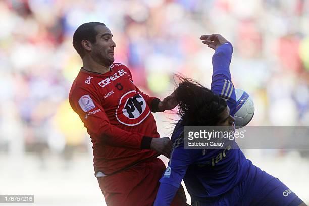 Ezequiel Videla of Universidad de Chile, struggles for the ball with Antonio Rojas of Ñublense during a match between Universidad de Chile and...