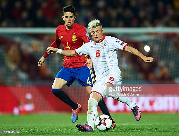 Ezgjan Alioski of FYR Macedonia being followed by Marc Bartra of Spain during the FIFA 2018 World Cup Qualifier between Spain and FYR Macedonia at on...