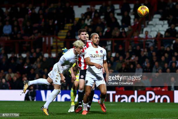 Ezgjan Alioski of Leeds scores the equaliser to make it one all during the Sky Bet Championship match between Brentford and Leeds United at Griffin...