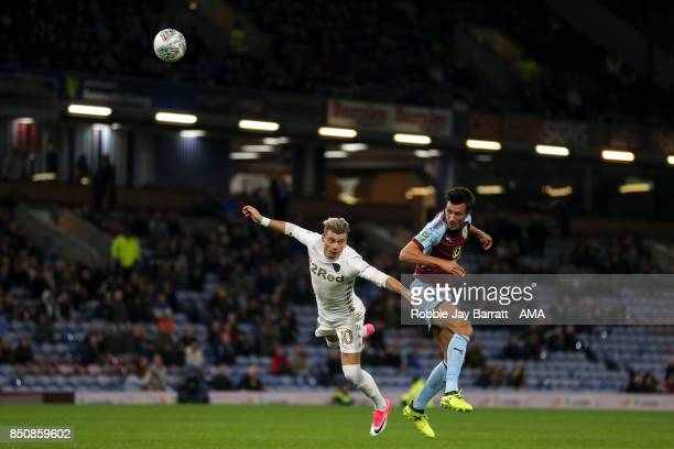 Ezgjan Alioski of Leeds United and Jack Cork of Burnley during the Carabao Cup Third Round match between Burnley and Leeds United at Turf Moor on...