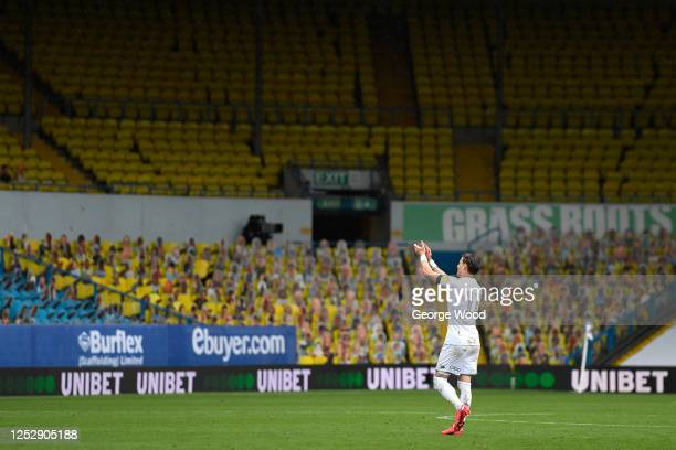 Ezgjan Alioski of Leeds United applauds the empty stands following the Sky Bet Championship match between Leeds United and Fulham at Elland Road on...