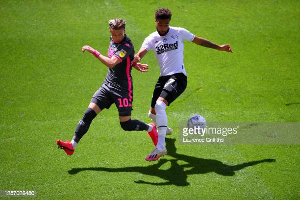 Ezgjan Alioski of Leeds United battles for possession with Jayden Bogle of Derby County during the Sky Bet Championship match between Derby County...