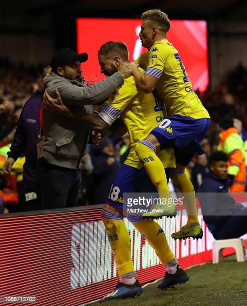 Ezgjan Alioski of Leeds United celebrates scoring his teams second goal with fellow tem mates during the Sky Bet Championship match between...