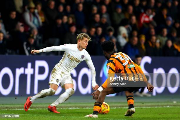 Ezgjan Alioski of Leeds United moves the ball past Hull City's Ola Aina during the Sky Bet Championship match between Hull City and Leeds United at...