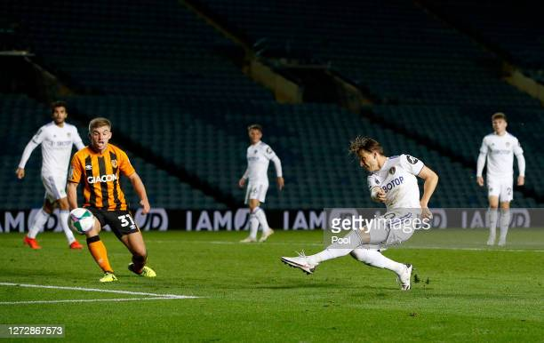 Ezgjan Alioski of Leeds United scores his team's first goal during the Carabao Cup Second Round match between Leeds United and Hull City at Elland...
