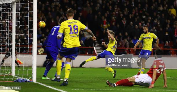 Ezgjan Alioski of Leeds United scores his teams second goal during the Sky Bet Championship match between Nottingham Forest and Leeds United at City...