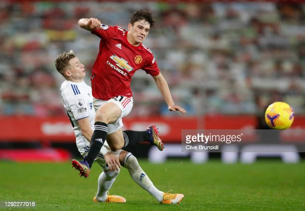 Ezgjan Alioski of Leeds United tackles Daniel James of Manchester United during the Premier League match between Manchester United and Leeds United...