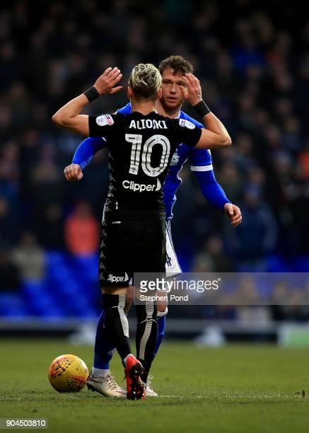 Ezglan Alioski of Leeds United and Joe Garner of Ipswich Town clash during the Sky Bet Championship match between Ipswich Town and Leeds United at...