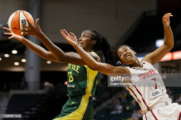 Ezi Magbegor of the Seattle Storm and Ariel Atkins of the Washington Mystics reach for a rebound during the fourth quarter at Angel of the Winds...