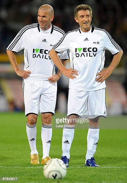 Ezio Greggio and Zinedine Zidane during the charity football game between National Singers and Team Ale 10 on May 18 2009 in Turin Italy on May 18...