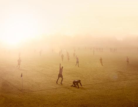 Football match at sunrise - gettyimageskorea