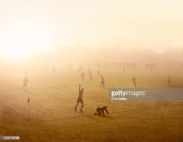 Football match at sunrise