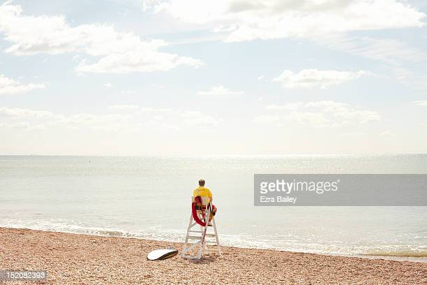 lifeguard looking out to sea - lifeguard stock pictures, royalty-free photos & images