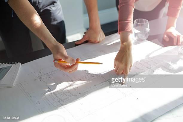 two business people discussing plans. - architekturberuf stock-fotos und bilder