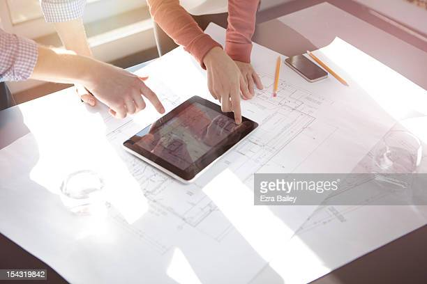 business people discussing plans on tablet. - architect stockfoto's en -beelden