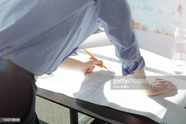 businessman making plans and designing. - linkshandig stockfoto's en -beelden