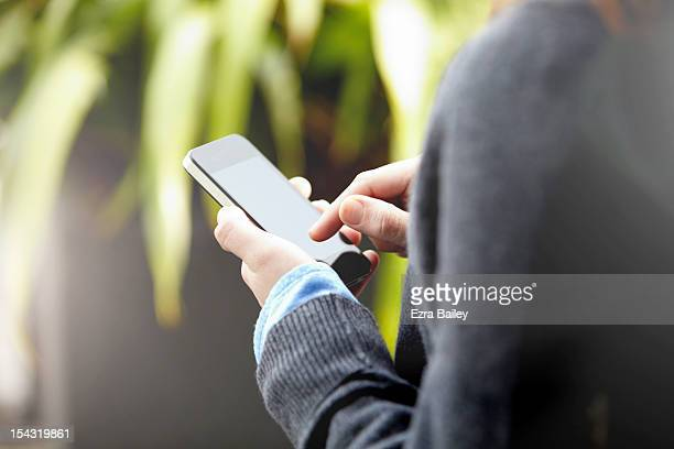 Close up of a woman using a mobile phone
