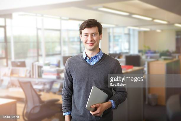 a young businessman in open plan office - 20 24 years stock pictures, royalty-free photos & images