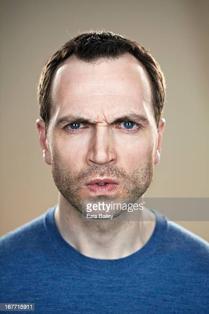 Portrait of a man looking angry.