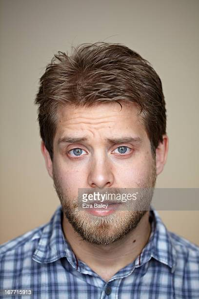 Portrait of a man looking into camera.