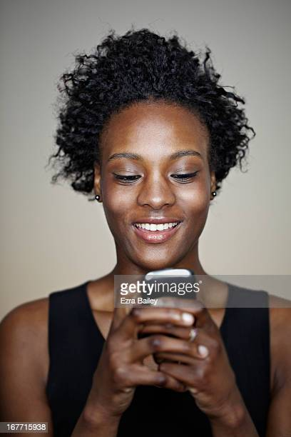 Portrait of a young woman checking her phone.