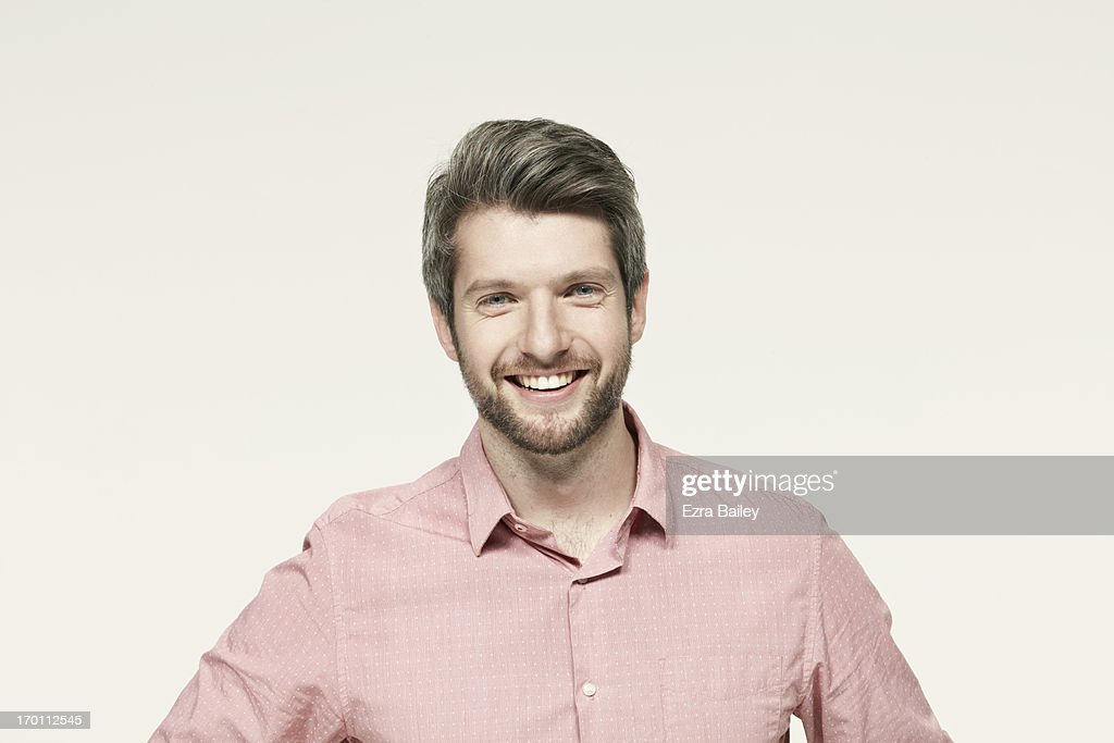 Man in a pink shirt smiling. : Stock Photo