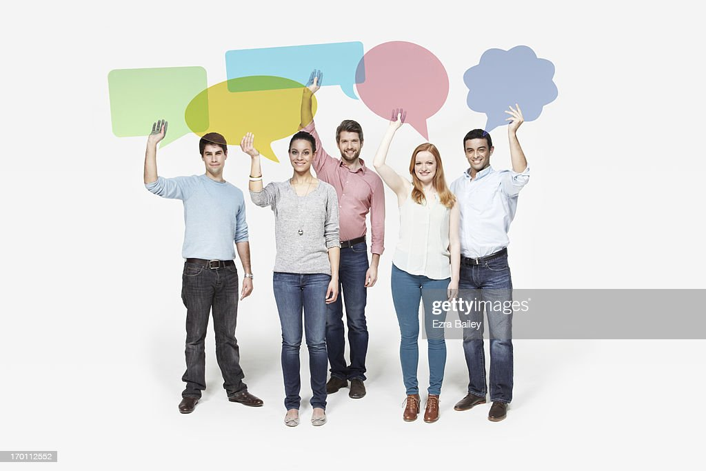 Group of people holding individual speech bubbles. : Stock Photo