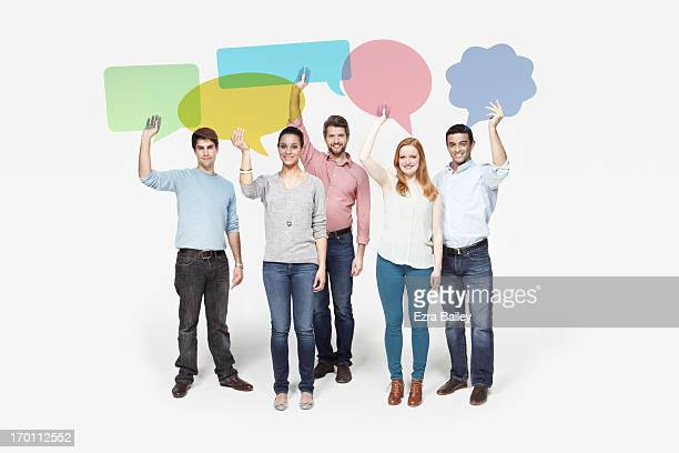 Group of people holding individual speech bubbles.