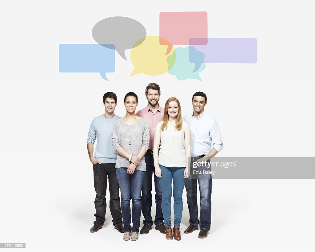 Group of people under speech bubbles. : Stock Photo