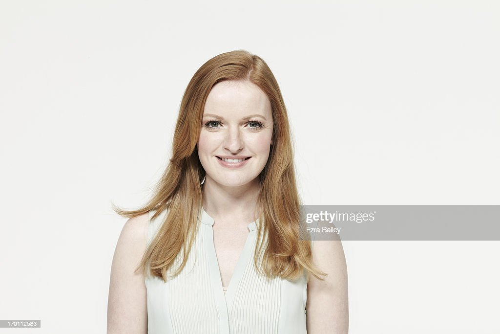 Woman with red hair smiling. : Stock Photo