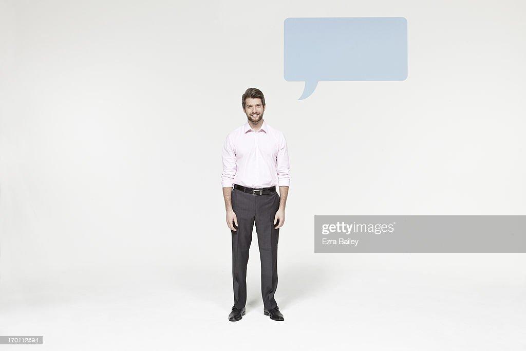 Man with speech bubble icon : Stock Photo