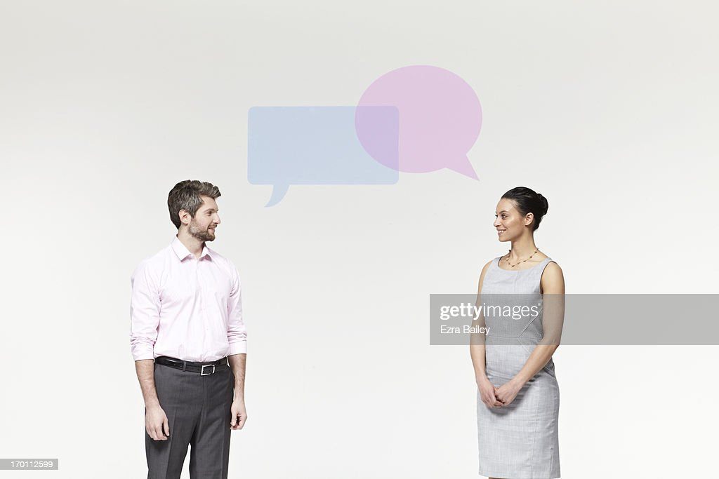 Man and woman with perspex speech bubbles. : Stock Photo