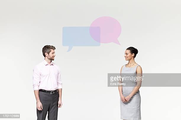 man and woman with perspex speech bubbles. - encarando imagens e fotografias de stock