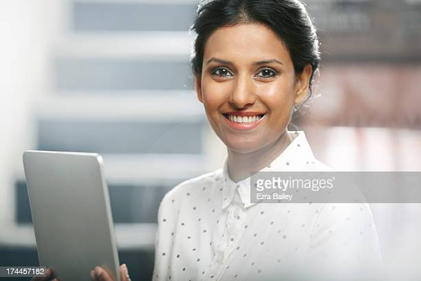 portrait of a business woman using a tablet. - overexposed stock pictures, royalty-free photos & images
