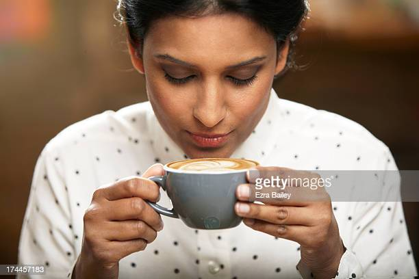 woman about to drink a cup of coffee. - caffè bevanda foto e immagini stock